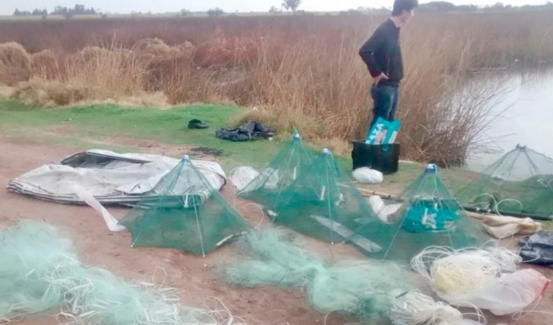 Sorprendieron a siete chinos que electrificaban el agua para pescar